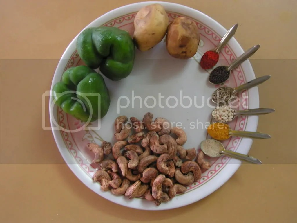 Ingredients of capsicum,potato & cashew mixed curry