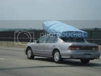 Transporting a thick double mattress on a roofrack of a ...