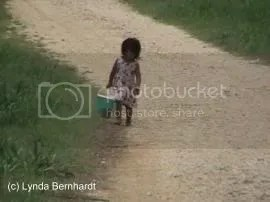 Girl with bucket (c) Lynda Bernhardt