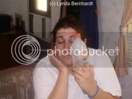 Woman holding bottle (c) Lynda Bernhardt