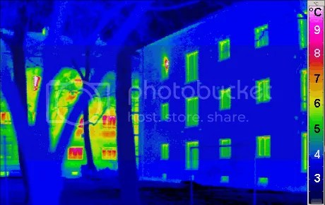 Superinsulation is a characteristic of most near, net- and plus-energy houses. In these infrared thermograms, the passive building on the right is emitting much less heat than the ordinary building on the left with very cold ambient temperatures.