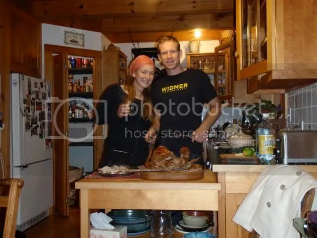 Carving up the Christmas turkey with my sister, Kendra