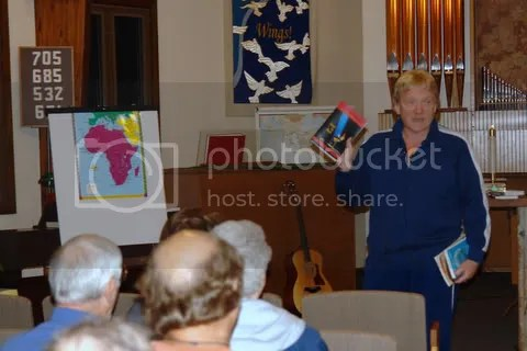 Rev. Hubbar shows books with Native Amiercan authors during the first TIP conference: