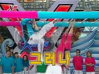 JJ and Yunho have a face off in one of the monkey bar games.