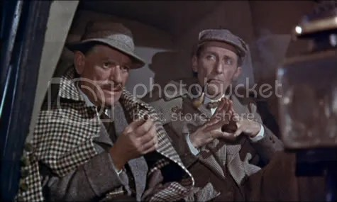 A two pipe problem - Watson (Andre Morell) & Holmes (Peter Cushing) mulling over a shaggy dog story.