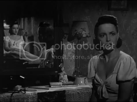 Two for the price of one - Olivia de Havilland in The Dark Mirror.