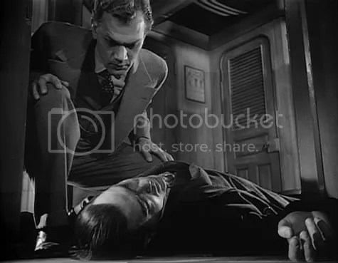 Joseph Cotten making another unwelcome discovery in Journey into Fear.