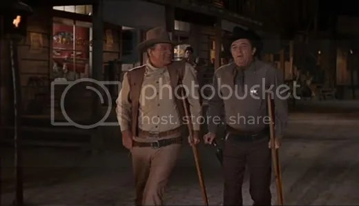 Even legends need a little support sometimes - John Wayne & Robert Mitchum in El Dorado