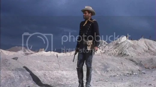 William Holden takes a lonely walk.