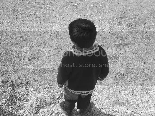 Parents tugging child photo: Child S4032744.jpg