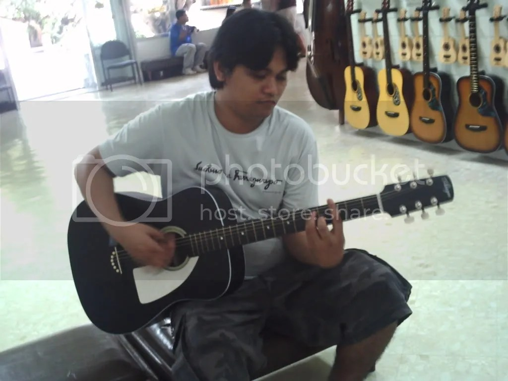 Joms trying out a guitar