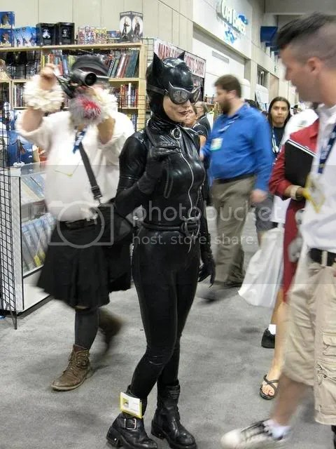 Okay, yeah, sure, there is a woman dressed like Catwoman in this picture, but we really want you all to notice the guy in the kilt behind her.  Outside of Scotland, youll not find more kilts than you do at the Con.  Know what, guys?  Never gonna happen.  We dont care how comfortable you claim these to be, it will never be widely accepted in modern America for a man to walk around in a skirt.