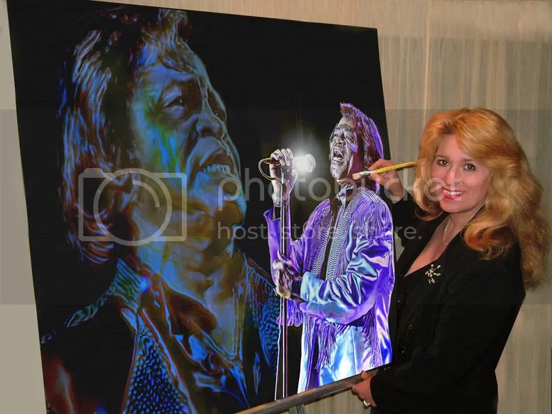 Artist McKenzie with James Brown Charity painting
