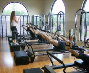 Pilates Reformer photo: Me teaching at my Pilates studio! RefomerClass.jpg