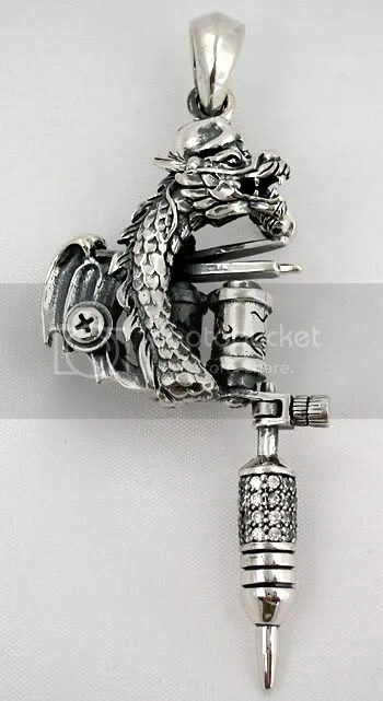 dragon tattoos machine gun pendant. AWESOME CARVING BY MASTER SILVERSMITH.