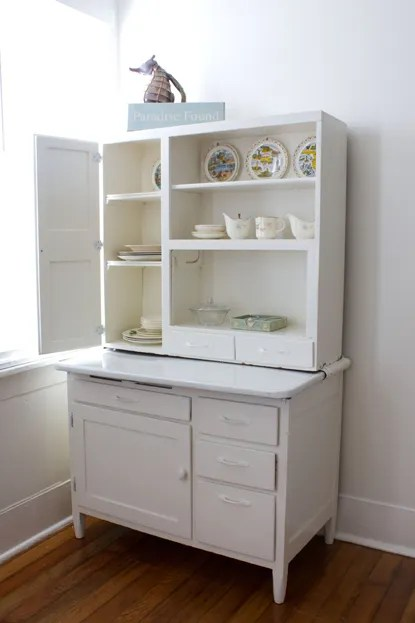 Decorating a Hoosier Cabinet and a Twin BedNightstand