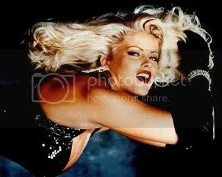 Anna Nicole Smith fabulous in diamond bracelet and black gloves