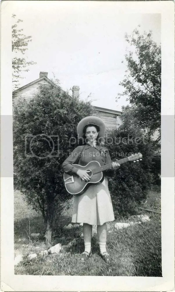 John Van Noate, Snapshot. Girl With Guitar And Big Hat