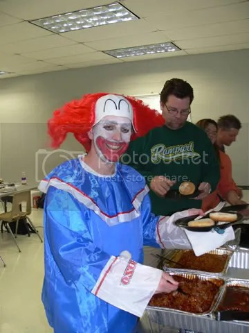 Eating lunch, catered by Corkys BBQ.  Note the deterioration of my clown makeup as the day wore on.  Im just like the Joker in the Dark Knight, sans the insanity!  Or, maybe not ...