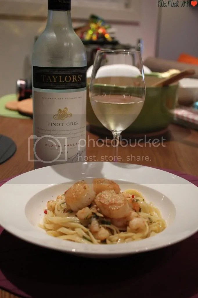 Prawn aglio olio with seared scallops paired with a glass of pinot gris