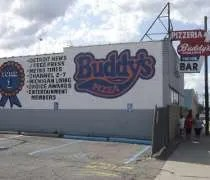 Buddys Pizza...proudly displaying the list of whos voted them the best.