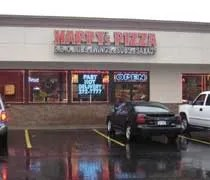Happys Pizza on the corner of Cedar and Miller in Lansing.