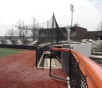 The stands and press box from field level at Illinois Field in Champaign.