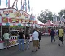 Row of food vendors near the midway at the Ingham County Fair in Mason