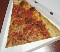 A slice of cheese pizza from Manolos Pizza & Empanadas in Urbana, IL