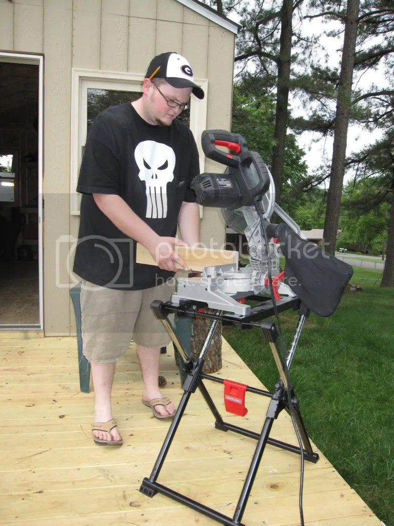 Josh was all over the place - cutting wood, attaching supports, measuring, painting - hes super useful to have around!