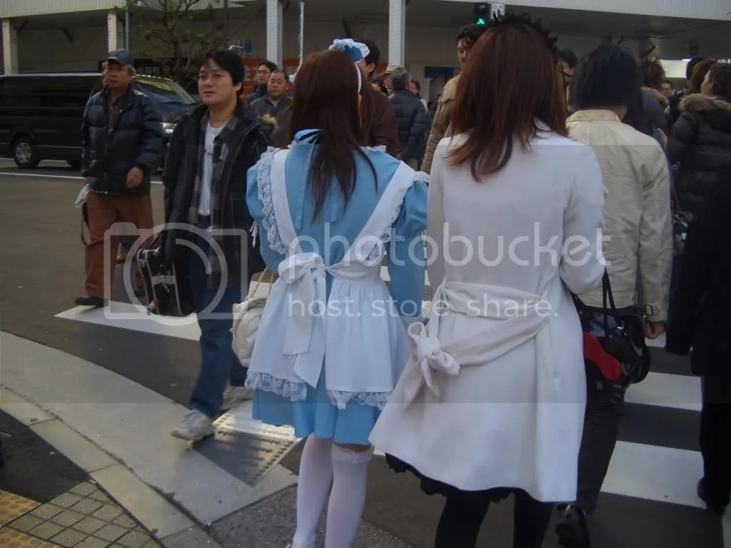 Sorry that this picture is from behind, but I think these maid outfits are little more typical. Particularly the maid on the left.