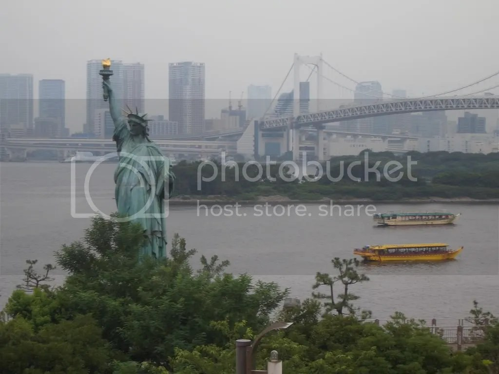 Miniature Statue of Liberty with Rainbow Bridge in the background