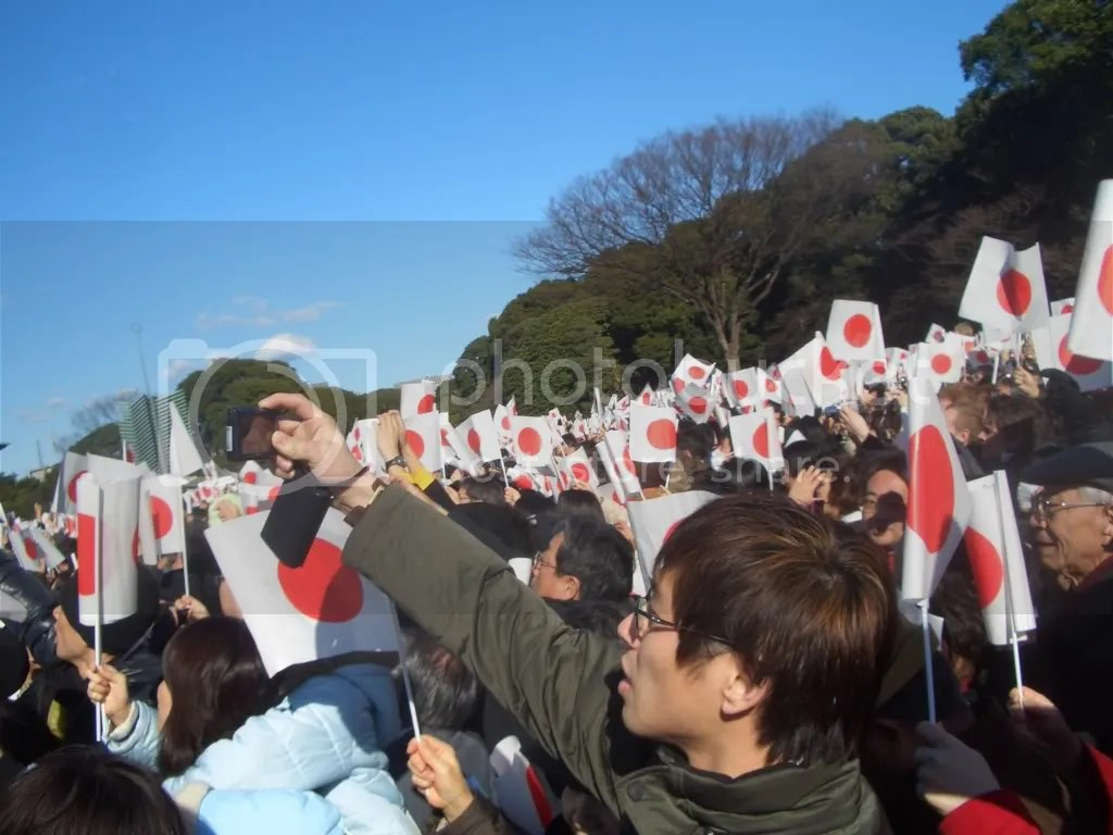 More of the crowd waving their Japanese flags