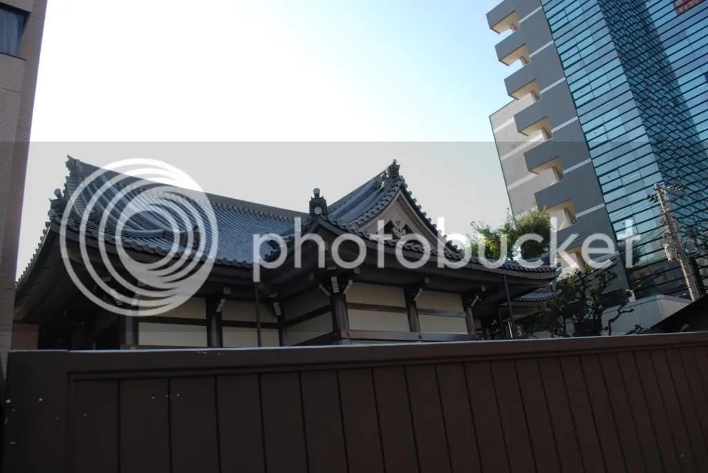 a temple hidden behind a fence