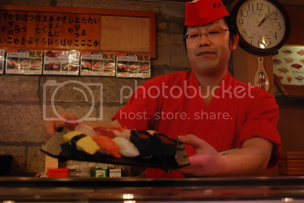 We were sitting at the counter, so we were able to watch the chefs prepare the dishes. Heres one of the chefs showing off a sushi set going to another customer.