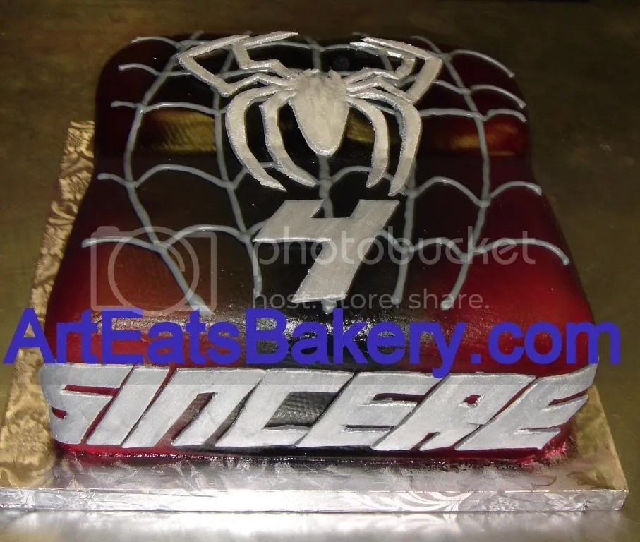 Spiderman birthday cake with silver sugar spider and web