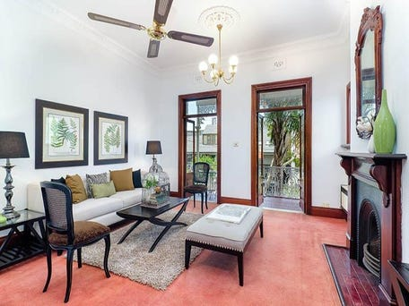 Carefully renovated lounge at 24 Arthur Street, Lavender Bay, retaining cornice, timber surrounds and fireplace surround.