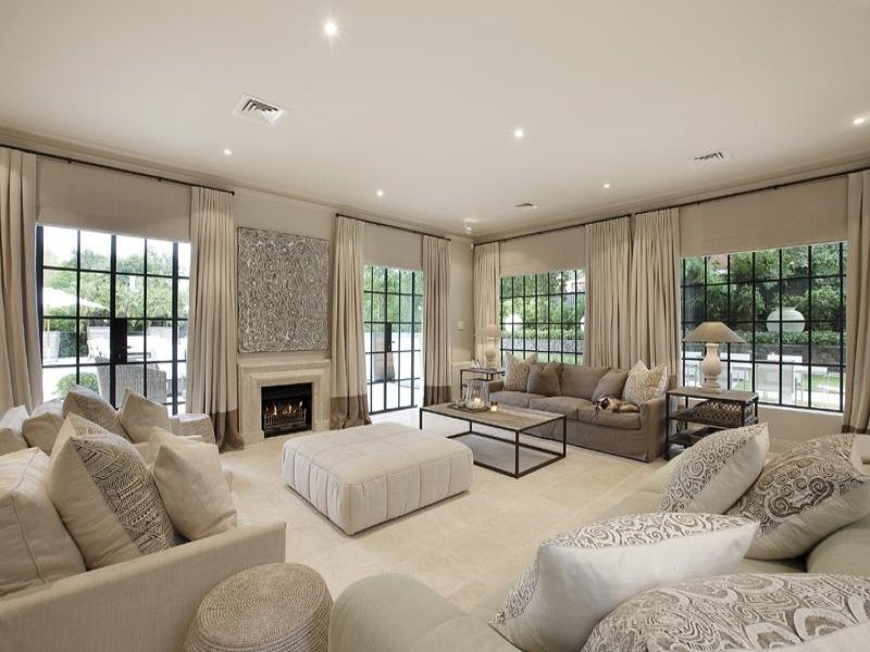 Splitlevel living room using white colours with tiles  floortoceiling windows  Living Area