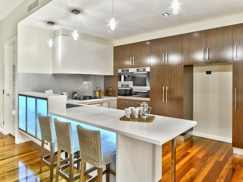 Modern ushaped kitchen design using floorboards  Kitchen