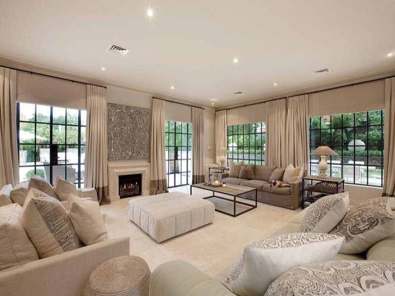 Open plan living room using beige colours with carpet  fireplace  Living Area photo 256047