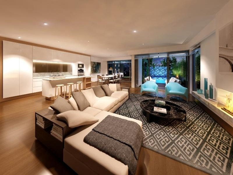 Open plan living room using brown colours with carpet  floortoceiling windows  Living Area