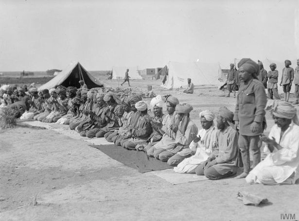 Indian troops in prayer at their camp