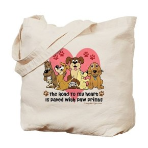 The Road To My Heart Dog Paw Prints Tote Bag  The road to my heart is paved with paw prints. Seven dogs and puppies in brown, beige and gray, with this lovely saying / quote. Dog lovers graphic design. Great for dog groomers, dog owners, dog day
