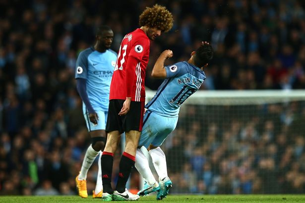 Marouane Fellaini clashes heads with Sergio Aguero