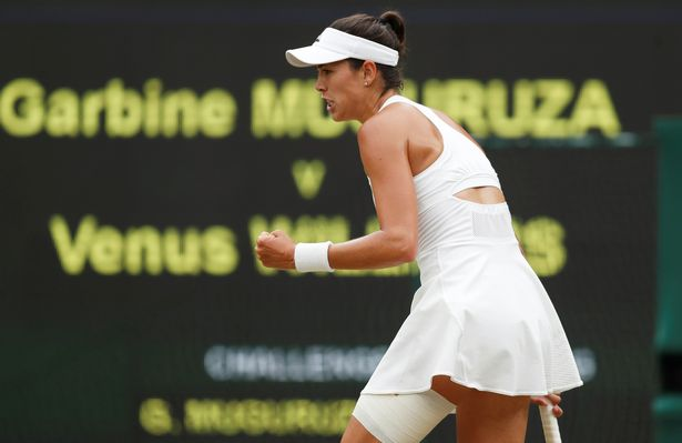 Muguruza celebrates during what was a one-sided victory (Image: REUTERS)
