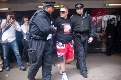 EDL leaders Tommy Robinson and Kevin Carroll are arrested while trying to march through Whitechapel, London