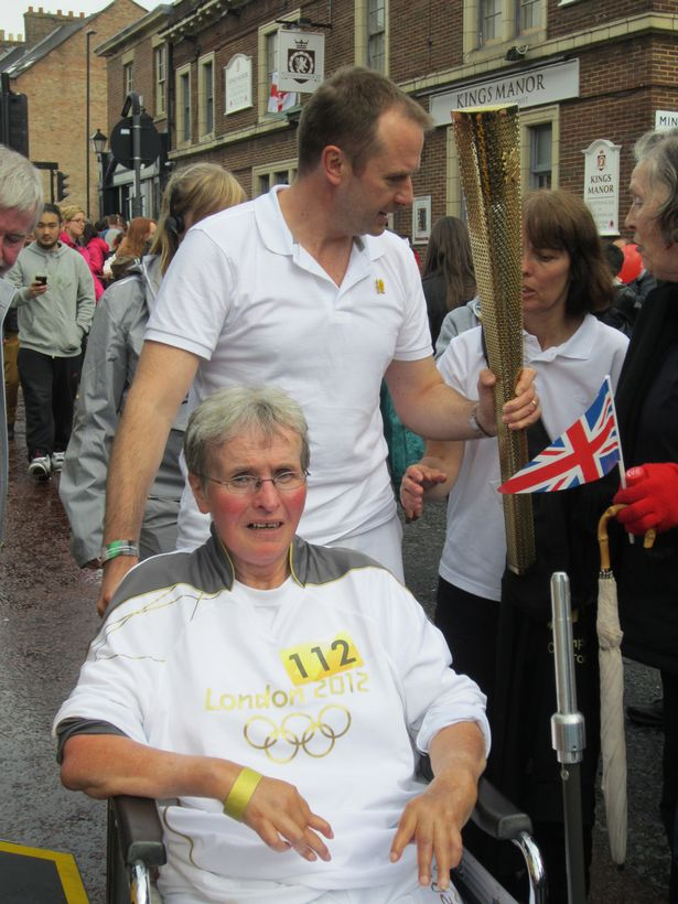 Mary Laver carrying the Olympic Torch
