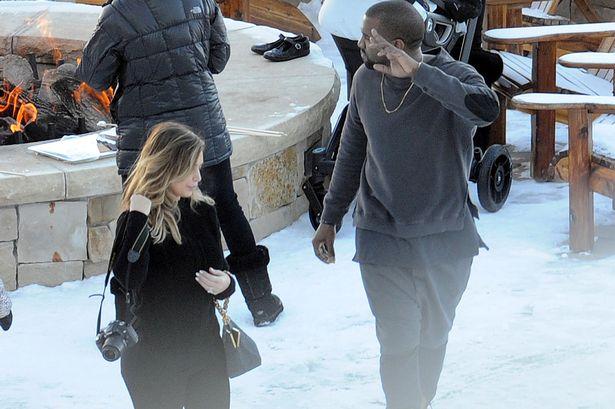 Kim Kardashian and Kanye West enjoy smores around the fire with their family