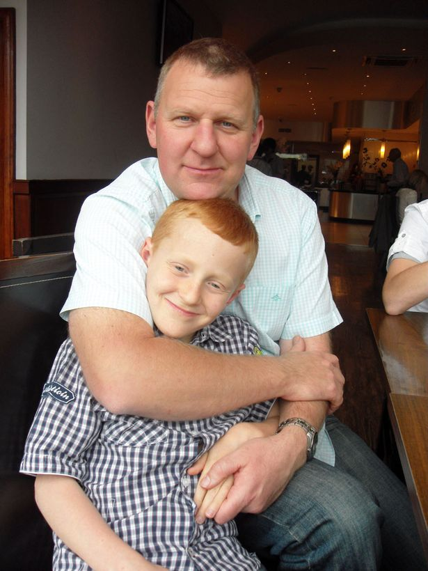 Simon with his father