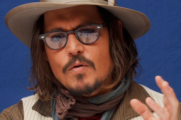 Johnny Depp poses for a photo during a portrait session at the Ritz Carlton Hotel